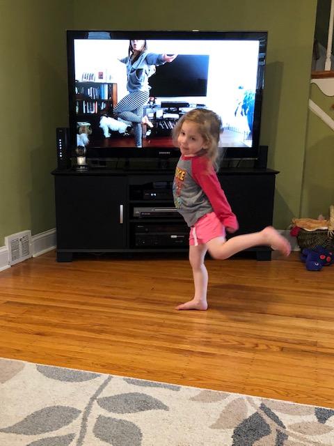 Child imitating gymnastics/movement poses